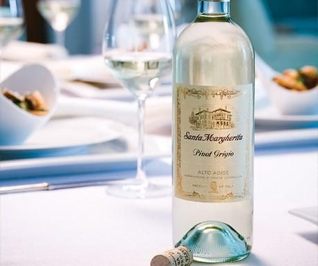 Santa Margherita Pinot Grigio  mmmmmm  Description from website:   Santa Margherita Pinot Grigio is the benchmark by which all other Pinot Grigios are judged. The wine boasts a fresh, clean fragrance that is followed by a crisp, refreshing flavor with hints of citrus fruits. This wine is well-structured and sophisticated, a perfect choice for entertaining!