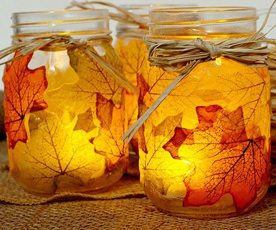 These Leaf Mason Jar Candleholders are way easy to recreate! Find more decor ideas here: http://www.bhg.com/thanksgiving/decorating/fall-mantel-decorating-ideas/?socsrc=bhgpin092814leafcandleholder&page=4
