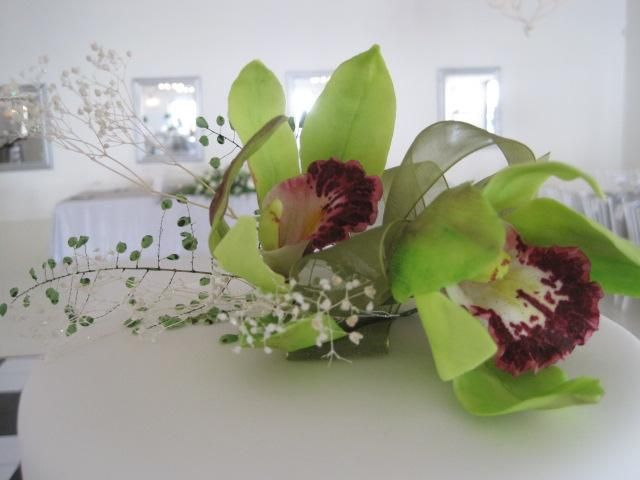 Orchid cake topper made from sugar.  Incorporating sugar fern and sugar baby's breath.  Hand made by Tania Riley Johannesburg, South Africa 0829316200