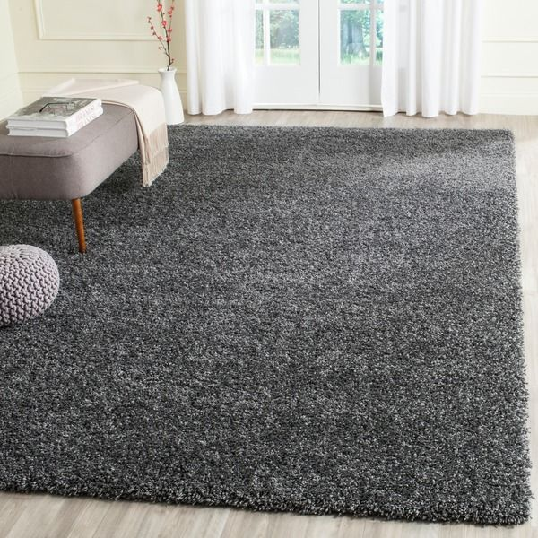 The casual West Coast aesthetic is celebrated in this rug from Safavieh's sensational California Shag Collection. This rug's dark grey color is complemented with nuanced shades of charcoal and silver