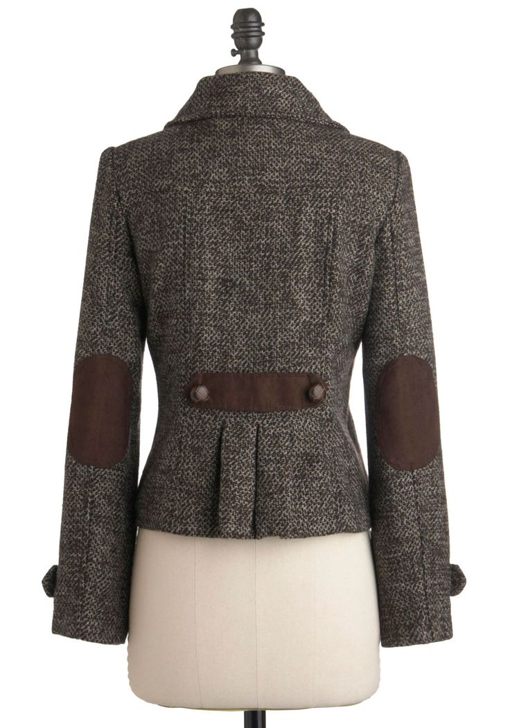 Leather elbow patches and godet on a tweed blazer.