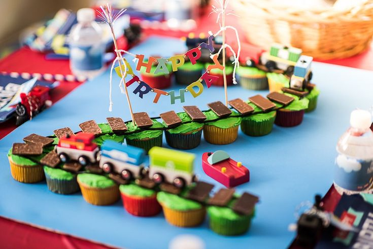 How to make a DIY train track birthday cake using cupcakes and licorice plus decorating ideas for a child's train-themed birthday party (chuga chuga TWO TWO!)