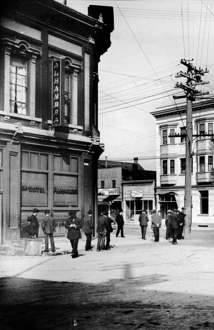 Maple Tree Square, 1907 From left to right: Hotel Alhambra, V. Straube's Shooting Gallery, BC Coffee House, Alexandria Hotel Source: Photo by Philip T Timms (cropped), City of Vancouver Archives #677-577