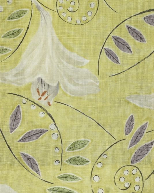 Angelica Fabric A floral lily painterly design curtain fabric, inspired by a Vanessa Bell painting, in white with mauve and green leaves, on a greeny yellow background.