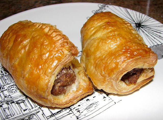 'Sausage Rolls'. A tradtional savory pastry served at parties or eaten as a snack. Often eaten with Colemans mustard. The basic composition of a sausage roll is generally sheets of puff pastry formed into tubes around sausage meat and glazed with egg/ milk before being baked. The sausage meat has herbs and spices such as sage, onion, pepper, salt and some breading. Can be served hot or cold.     Historically, during the 18th century they were made using shortcrust pastry instead of puff…