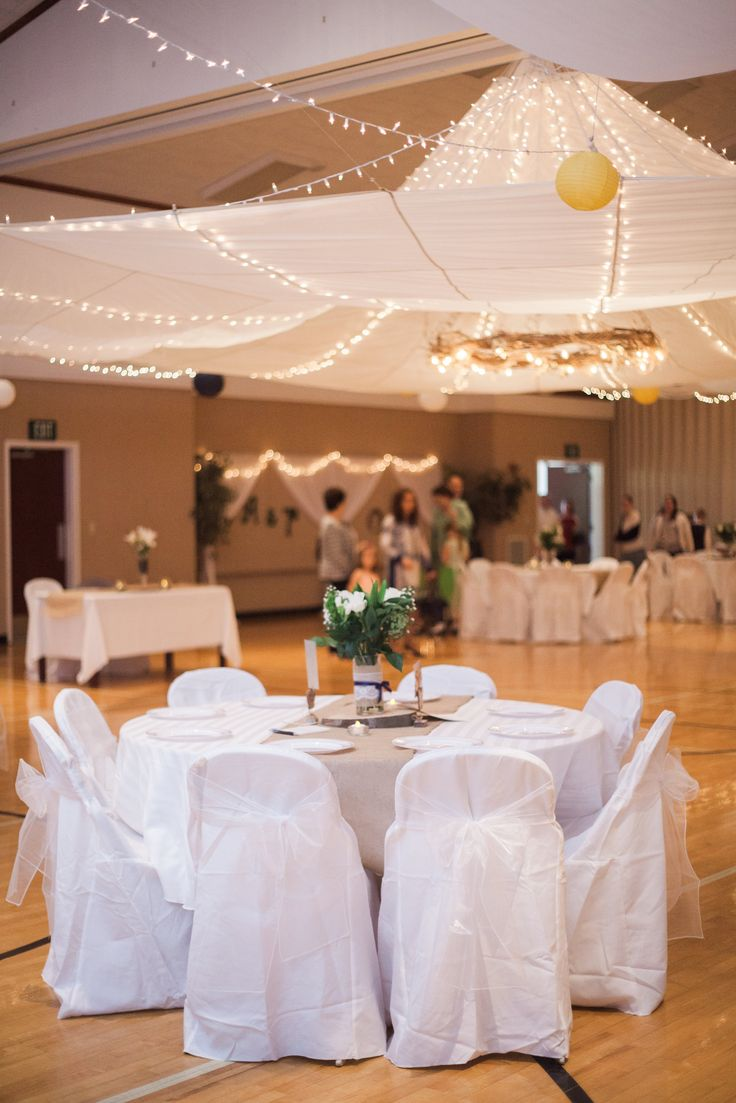 In The Center Of Reception Hall Hung A Large White Parachute With Lights Safety Pinned