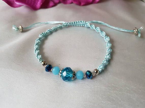 Check out this item in my Etsy shop https://www.etsy.com/uk/listing/518826962/pale-blue-macrame-bracelet-beaded
