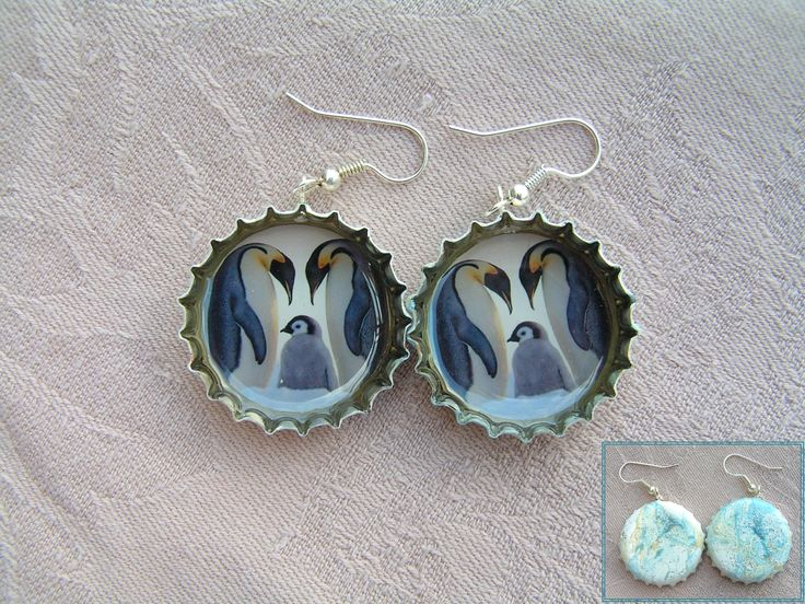 Pinguen family earrings in water marble painted and glittered bottle caps.