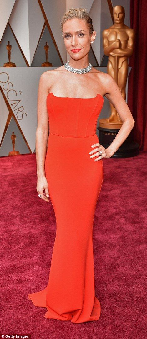 Red alert! EAT SOMETHING Kristin Cavallari wore a strapless scarlet gown, complete with a diamond choker...