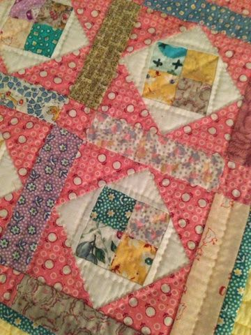 pink little quilt with squares