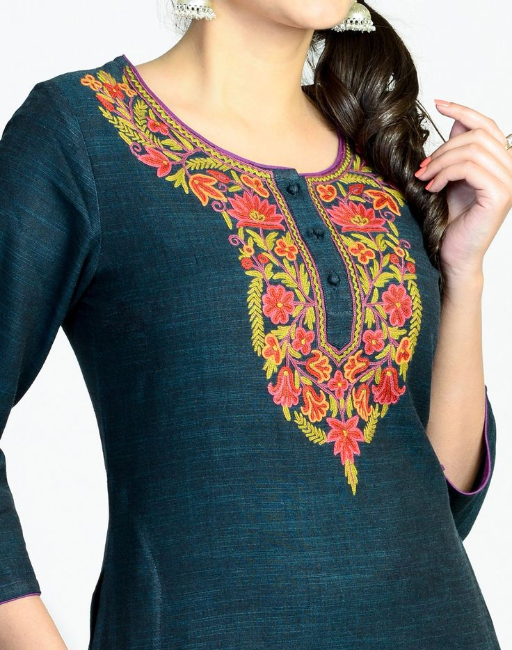 Kurta with a contemporary twist. Featuring beautiful Kashmiri embroidery, this kurta is made using a slub cotton and is perfect for a day to evening wear.  Cotton Slub Kashmiri Embroidery Round Neck 3Q Sleeves  A-line Fit Hand Wash Separately in Cold Water