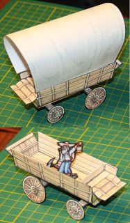 Here's a covered wagon from the Wild West. This model was originally posted at Cardboard Warrior...