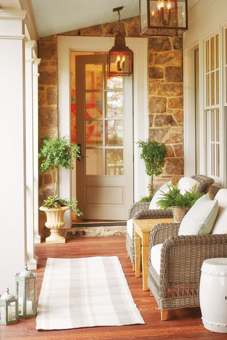 Two chairs from our Laurel Collection, a teak side table, and an outdoor runner turn this breezeway into a charming space to drink your morning coffee or sip a glass of wine at the end of the day.