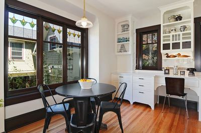 Queen Anne 1903 craftsman with architect remodel well done. Like light fixture, stained glass windows, dark paint for woodwork, built in storage/desk area (part of kitchen). 1712 3rd Ave N. 4/3.5 with 6Ksqft lot.