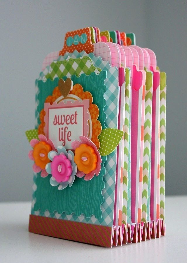 Check out Shellye's darling POCKET ORGANIZER that can hold your monthly memories, milestones, birthdays, etc.  And all you will need is a variety of the new Treat Bags, a couple of sheets of your favorite 12x12 papers and fun embellishments!