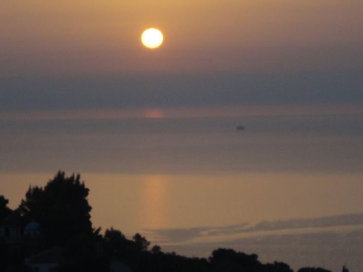 Sunrise over the Aegean Sea, in front of Kimi