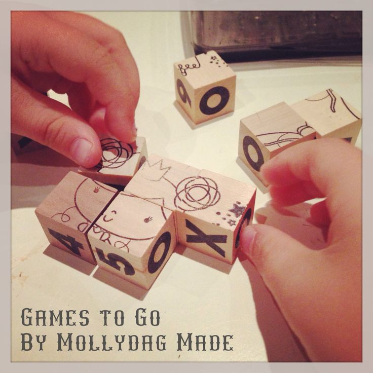 Test-driving a new game before bed. #mollydagmade, #games to go, #wood picture blocks, #tic-tac-toe