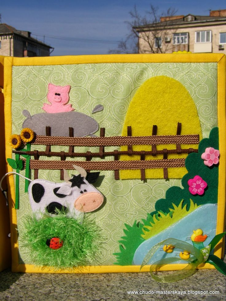 I love the faux grass on this farm animal quiet book page. I think I have some of that fuzzy yarn.