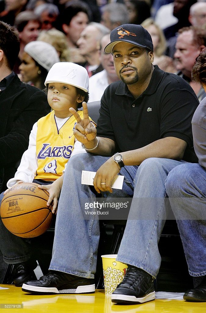 Actor/musician Ice Cube and son O'Shea Jackson Jr. attend the game between the Los Angeles Lakers and the Dallas Mavericks at the Staples Center on March 4, 2005 in Los Angeles, California.