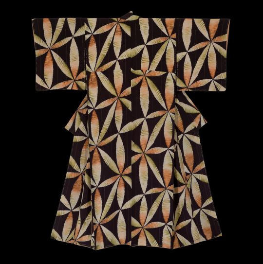 A chirimen silk kimono featuring imaginary flowers created by an unusual and unidentified technique. – each motif is slightly different than the others. Occasional gold threads as a vertical insert.  Taisho period (1912-1926), Japan.  The Kimono Gallery