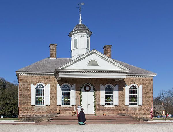 Two ladies catch up on the latest gossip at the Courthouse in Colonial Williamsburg, Virginia