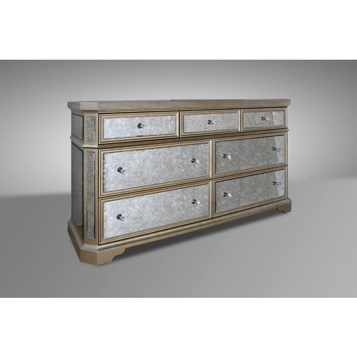The Evans transitional mirrored dresser is a mixture of modern and traditional design, making it look exclusively elegant. Gold accents are seen on the edges with strong transitional legs. Functionality is not left out with three medium-sized drawers and four expansive drawers. Adding to its elegant style are the bolt-like drawer pulls.
