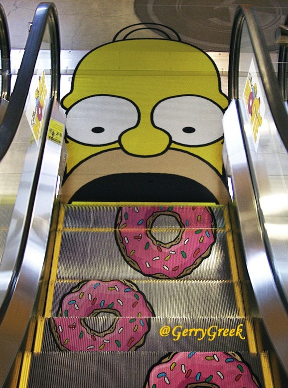 Probably the most INGENIOUS idea I've seen for weeks! Ladies & Gents I present you: The Homer Simpson Escalator!: Stairs, Doughnuts, The Simpsons, Street Art, Donuts, Homer Simpsons, Guerrilla Marketing, Funny Commercials, Streetart