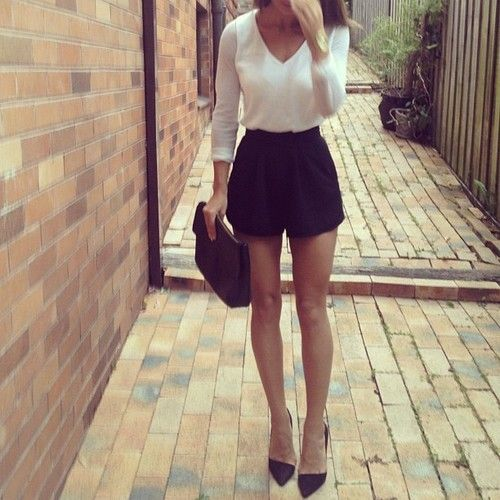 simple yet classy summer outfit | black shorts and white long sleeve shirt with assymetrical flats or heels
