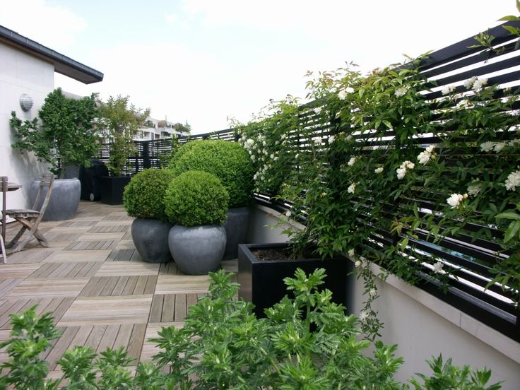Terrace Balcony | Accent of France - this batten-style of trellising gives a contemporary look whilst helping to filter the wind.