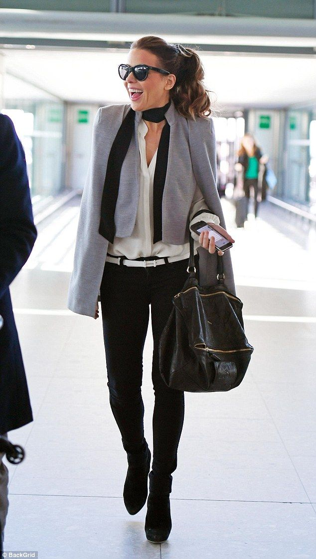 Home again: Kate Beckinsale touched down on English soil looking glamorous as ever on Sunday after filming wrapped for the drama The Widow