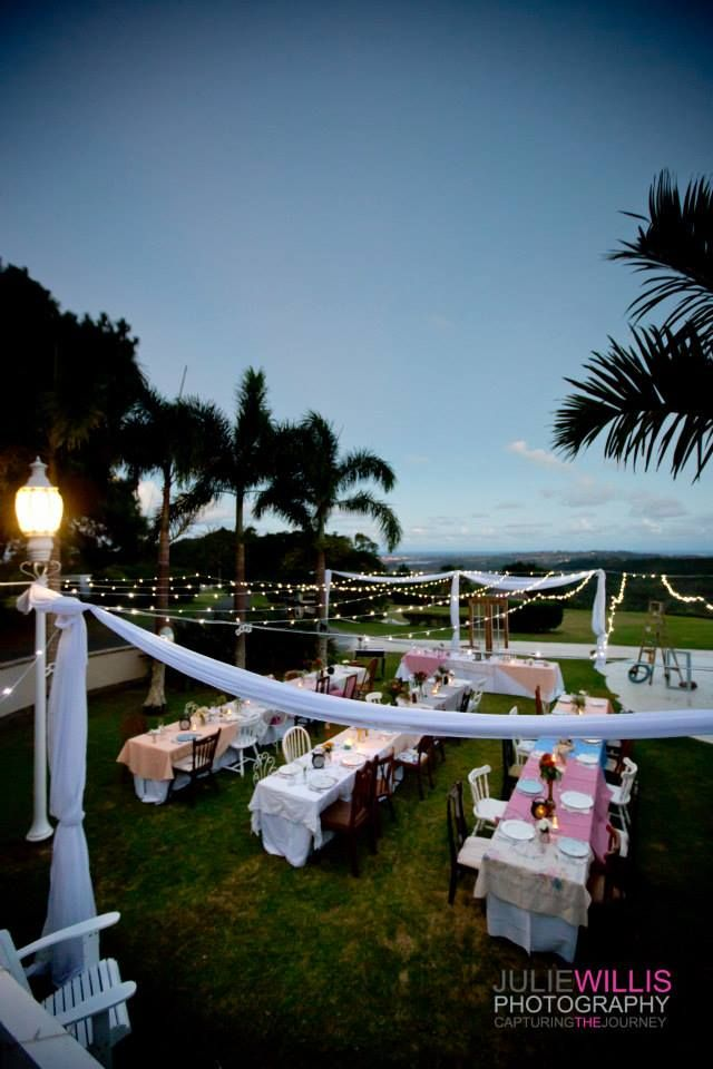 Stunning outdoor reception with twinkling coastal lights as a backdrop. Open air marquee Summergrove Estate