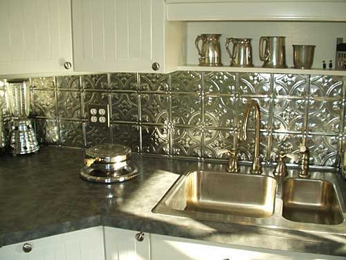 Stainless Steel Tin Tiles Make A Modern Kitchen Backsplash.