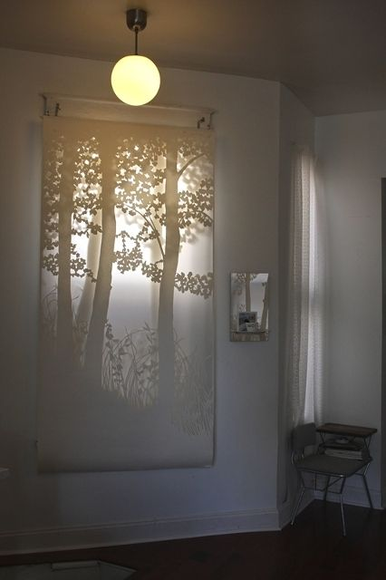 cut paper window treatment. beautiful