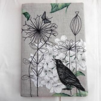 Embroidered and appliqued covered notebook