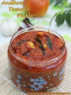andhra tomato pickle 500 Gms chopped tomatoes 6 tbsp. red chili pow 1 tsp. turmeric pow 80 Gms tamarind methi seeds 1 tbsp ) 2 tbsp. sunflower oil for frying tomatoes Salt as per taste Seasoning 90 ml mustard oil 1 sprig curry leaves 1 tsp. jeera 1 tsp. mustard 1 tbsp. channa dal 1 tbsp. urad dal 6 cloves of garlic 1 red chille deseeded Pinch of hing