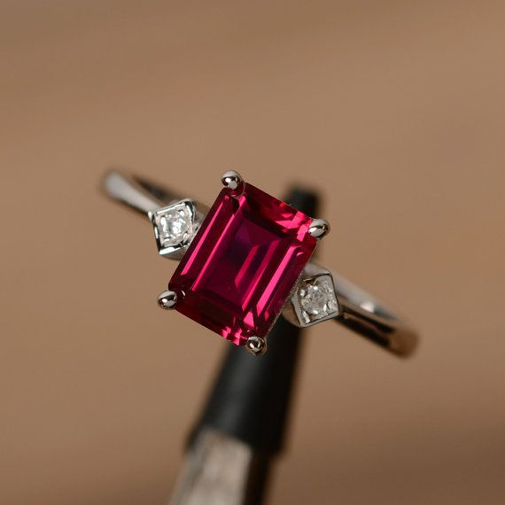love the gem cut and the simplicity maybe a darker ruby lab ruby are not the best but cheaper, emerald cut gemstone ring July by godjewelry on Etsy