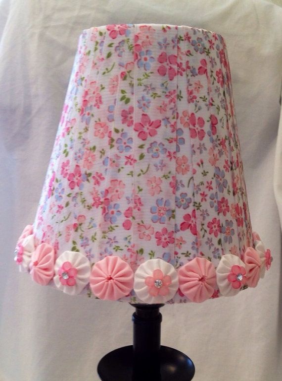 lampshade wrapped with ribbon and accented with pink and white fabric decorgirls room