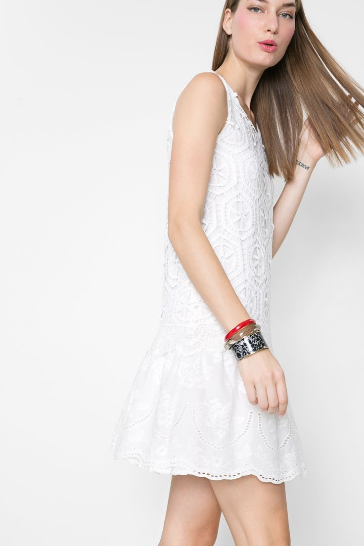 Wear this cute white lace dress by itself for a classy summer look or pair it with heels and a patterned clutch for those summer weddings. Find it in Desigual's SS16 collection.