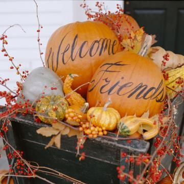 Fall Entertaining is made easy with the help of World Market! They have all the bases covered to make your holiday get-together's a breeze. I love the rustic nature of decorating and entertaining during the autumn season. Guests will feel welcome when this antique wheel borrow with painted pumpkins greets them at the door!