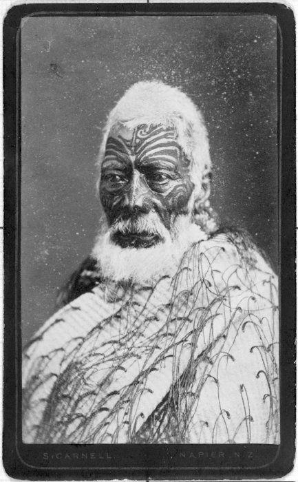Matenga Tukareaho, [ca 1870] Head and shoulders portrait of Matenga Tukareaho of Nuhaka. He has a full facial moko and wears a tag cloak. Photograph taken by Samuel Carnell.
