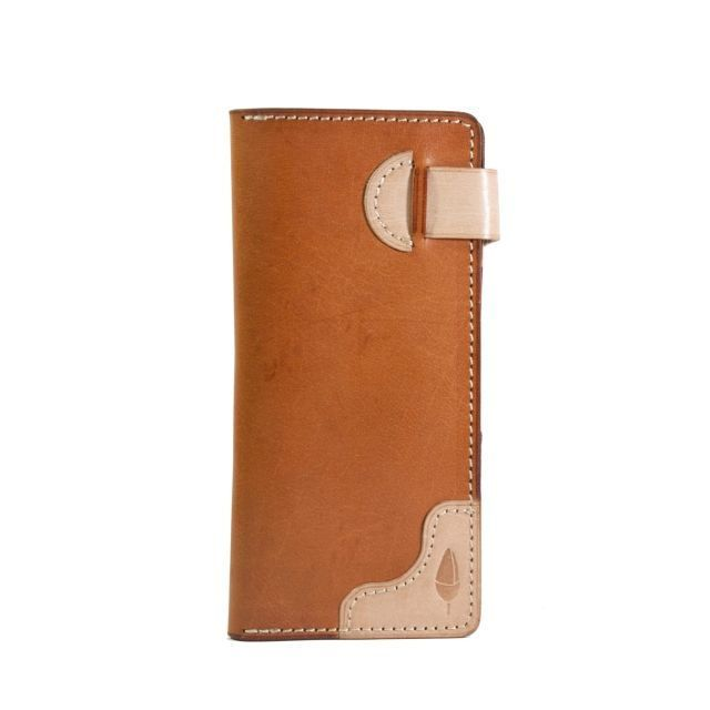 - Exterior and Interior using vegetable natural + tanned buffalo leather - Machine Stitch - Burnished edge  - 12 Card Slots - 2 Money Slots - 1 Coin Pouch - 1 Hidden Slot