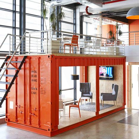 A bright red shipping container at the entrance to the offices of Cape Town branding agency 99c houses a waiting room for visitors.