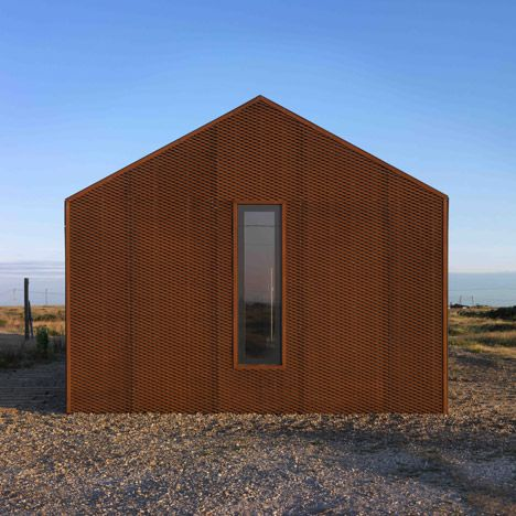 Architect Guy Hollaway used rusty steel mesh, silvery larch and grey cement fibreboard to clad this house on Dungeness beach – Britain's only desert..