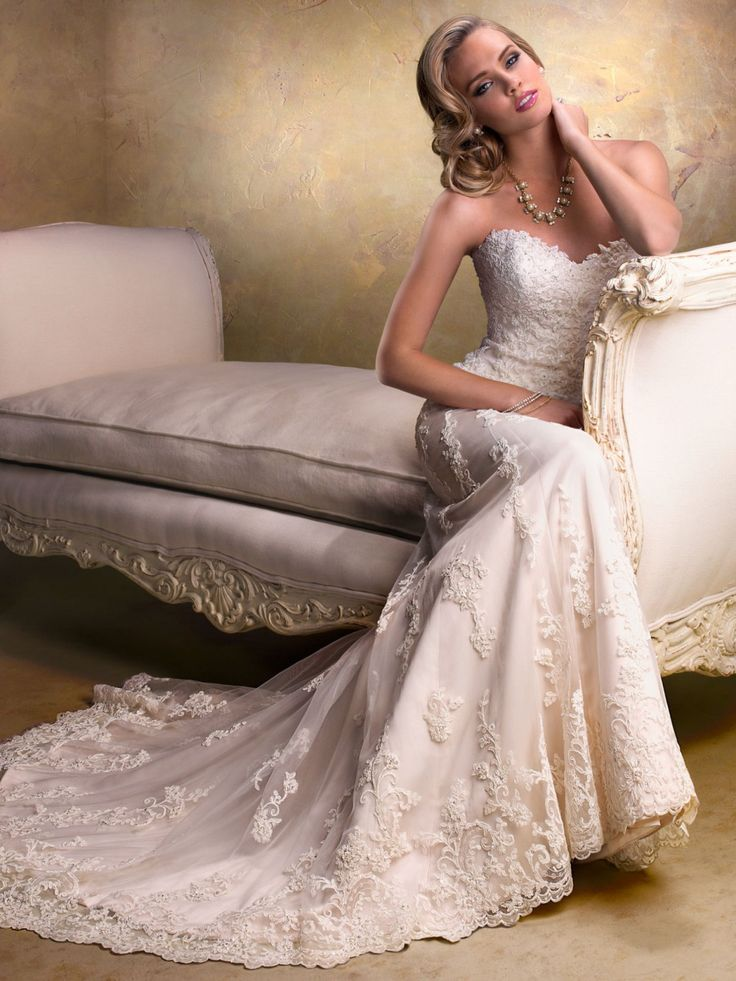 Maggie Sottero - EMMA, With an eye to timeless romance, this slim wedding dress features a delicate, sweetheart neckline and gorgeous beaded lace motifs dancing across tulle. Finished with corset back or zipper back closure.