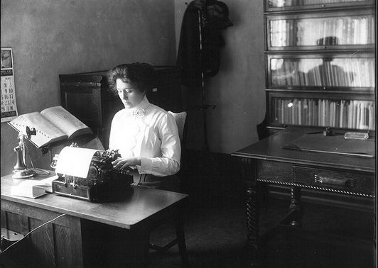 """Photo of a secretary at her typewriter, 1912. Source: Miami University Libraries. Read more on the GenealogyBank blog: """"Help Wanted-Female Classified Ads: Working Women Ancestors."""" http://blog.genealogybank.com/help-wanted-female-classified-ads-working-women-ancestors.html"""