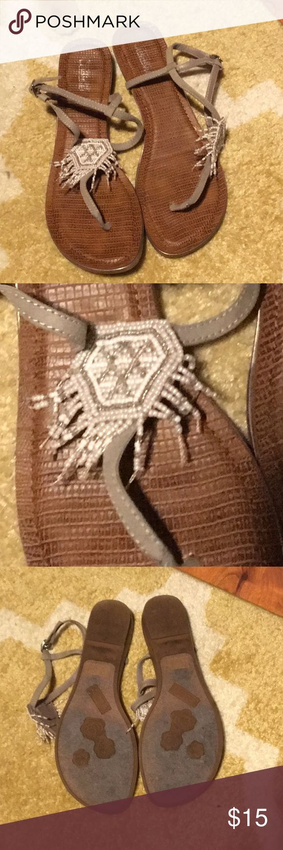 Carlos Santana 👡 sandals These sandals have a beaded accent that makes them perfect for a trip to the beach. They are ideal for spring break or a beach wedding. Carlos Santana Shoes Sandals