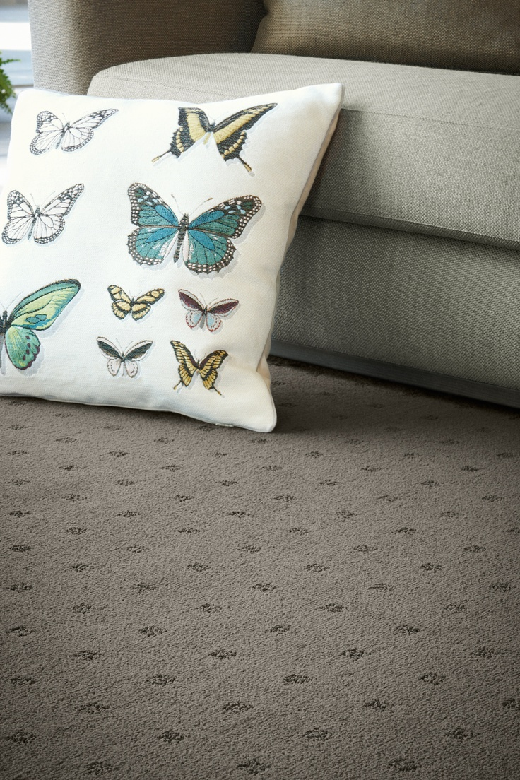 A nature inspired butterfly cushion complements our Habitat level cut loop pile carpet.  From our Redbook green range, you can add another level of comfort to your home.