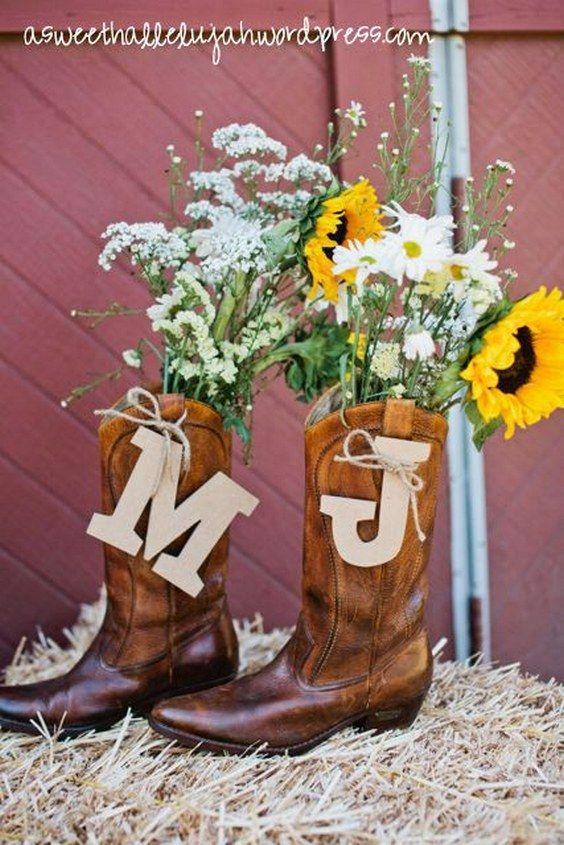 cowboy boot centerpieces / http://www.deerpearlflowers.com/cowgirl-boots-fall-wedding-ideas/