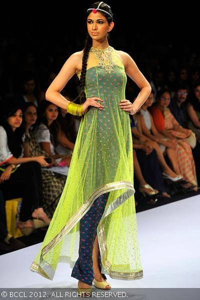 A model showcases a creation by designer Payal Singhal during the Day 1 of Lakme…