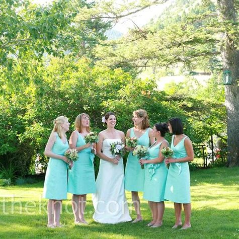 Aqua Bridesmaid Dresses   Kate's sister, two friends, and two sister-in-laws served as her attendants. Kate wanted them to be comfortable, so she selected light blue cotton dresses with silver jewelry